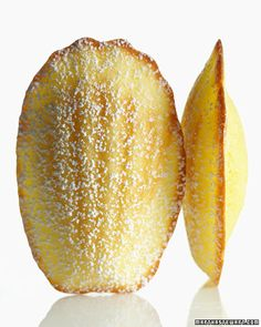"""Lemon Madeleines...""""Tiny, tender cakes are enriched with egg yolks and flavored with lemon juice and zest."""" So dainty and pretty."""