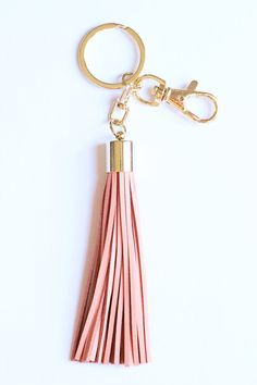 **Introducing our new luxe leather tassels! Making every set of keys glam!**  This blush tassel comes with both a keyring and also a clip that looks