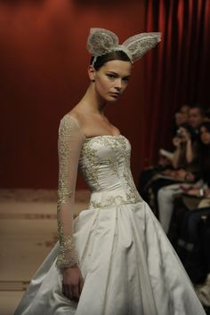 i would fall over if one of my brides wore this down the aisle...