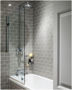 Grey subway tiles look great in this modern bathroom. - Grey subway tiles look great in this modern bathroom. Upstairs Bathrooms, Grey Bathrooms, Bathroom Renos, Beautiful Bathrooms, Bathroom Ideas, Grey Bathroom Tiles, Tub Tile, Budget Bathroom, Simple Bathroom