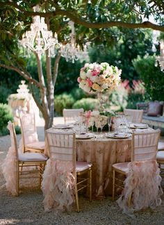 """Love the ruffle chair-skirts. So lavish and feminine! Chandeliers hanging from trees are always a """"yes!"""" (#garden weddings, #pink weddings, #spring weddings)"""