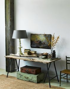 What a beautiful statement for an entryway. All this beat-up salvaged door needed to make it a gorgeous table was a pair of metal trestle le...
