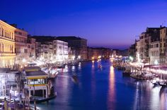 Float down the canals in Venice at night for a different view of the city.
