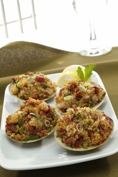 Paul O'Connell pays tribute to New England's traditional dish with flair! Click to get the recipe for his delicious Baked Stuffed Clams! #NewEnglandPatriots