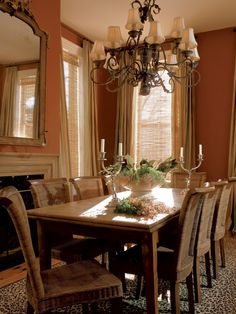 Neutral Linen Curtains Hang In A Burnt Orange Dining Room Leopard Print Rug