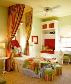 I love the colors and the little table at the end of the bed. CUTE