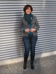 I totally want to copy this outfit; I love wearing circle scarves & brooches together. Great way to stay cozy AND look polished!