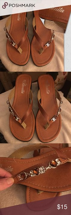 BNWOB cognac embellished thongs All prices are firm unless bundled.                          Bonita brand Brand-new, no box, never worn Labeled size 10, fits like a 9M  Thong style with Crystal and silver embellishment on the right side of shoe Do not flip flop when you walk in, very comfortable. Bonita Shoes Sandals