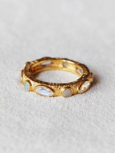Halo Band Ring | Environmentally friendly hand carved and crafted 22k gold plated ring with a hand etched band. Features beautiful faceted Ethiopian opal stones and a rainbow moonstone inlay. *Bahgsu Jewels