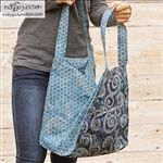 The Tribeca Tote features an eye-catching front & back pieced panel using a modern-take on the Seminole patchwork quilting method ideal for using jelly rolls or bali pops. Large side gussets allow this slim tote to expand to a roomy bag.