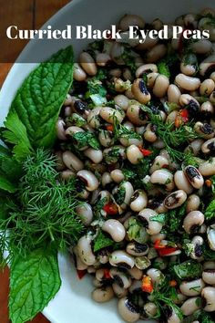 Curried black-eyed peas with fresh herbs. Black-eyed peas are popular as a lucky food to eat on New Years Day. But this wonderful side dish should make an appearance all year long. Low fat, high in fiber and packed flavor! @venturists