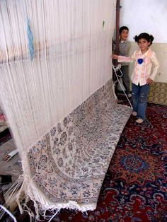 Children learn to weave a carpet at early age.  The carpet in the picture is a Nain. We share a link of our website where you can find the result of weaving these fine carpets. http://www.bizsan.hu/en/rugopedia-page/7