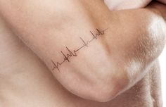 Simple heartbeat tattoo
