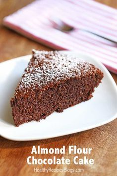 A fluffy, gluten-free chocolate cake, made with almond flour and sweetened with a touch of honey. #glutenfree #paleo