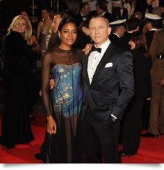 Daniel Craig and Naomie Harris attend the premiere of the latest James Bond film Skyfall on Tuesday October 23 at Royal Albert Hall in London, England. Naomie Harris plays an agent named Eve. Naomie Harris is dressed in a Marios Schwab gown. Daniel Craig Skyfall, Extraordinary Gentlemen, Nice Dresses, Formal Dresses, Royal Albert Hall, Halle, Film, Strapless Dress Formal, Hollywood