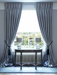 Overlong grey curtains puddle on the floor with a double pleat heading hung on a lath & fascia Prêt à Vivre   Design Ideas