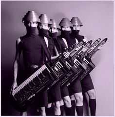 """Devo - an American New Wave band formed in 1972 consisting of members from Kent and Akron, Ohio. The classic line-up of the band includes two sets of brothers, the Mothersbaughs (Mark and Bob) and the Casales (Gerald and Bob), along with Alan Myers. The band had a No. 14 Billboard chart hit in 1980 with the single """"Whip It"""", and has maintained a cult following throughout its existence."""