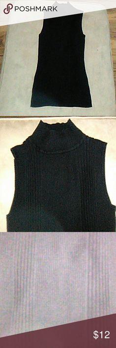 Sleeveless crew neck sweater This tunic length black sleeveless crew neck sweater is a great addition to any wardrobe Dress Barn Sweaters Crew & Scoop Necks