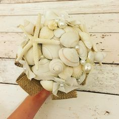 I made this shell bouquet for my best friends wedding. Every evening for 2 whole weeks spent gluing shells to wire sticks. She loves it and I love it :) #nautical #shellbouquet #nauticalwedding #diy #seaside #handmade www.facebook.com/MadeByGemmaBunting Shell Bouquet, Make And Sell, How To Make, Beach Crafts, Nautical Wedding, Friend Wedding, Bunting, My Best Friend, Seaside