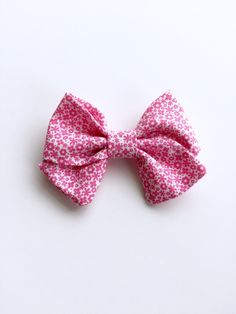A personal favorite from my Etsy shop https://www.etsy.com/listing/273733190/bright-pink-floral-print-bowheadbandbaby