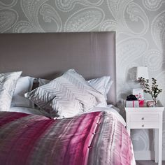 gray and pink bedroom with paisley wallpaper