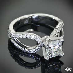 "This ""Infinity"" #Diamond #EngagementRing is set in platinum and has been customized to hold a beautiful 1.034ct A CUT ABOVE® Princess Cut Diamond. A gorgeous #ring"