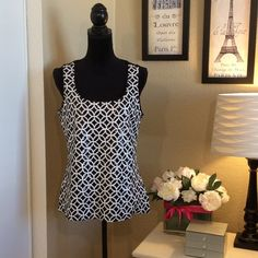 WHBM sequined geometric patterned front tank Sparkly sequins dazzle in a geometric pattern on the lined front bodice, the back is a solid black soft modal and spandex fabric. White House Black Market Tops Tank Tops