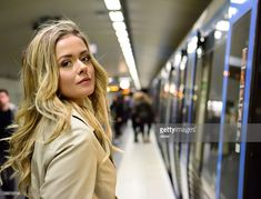 https://www.gettyimages.com/detail/photo/blonde-swedish-woman-entering-commuter-subway-train-royalty-free-image/586715718?esource=SEO_GIS_CDN_Redirect