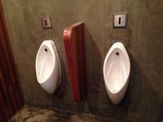 Men's urinals + divider