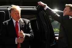 A protection specialist holds the Principal's door as Republican Presidential candidate Donald Trump exits the limo and returns to his midtown office after voting on primary day in New York on April 19, 2016 in New York City.