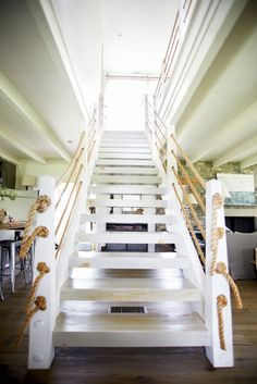 Wonder if a rope railing would be to code? May be too much with the nautical theme, but it would mean not cutting off access to any wall cubbies
