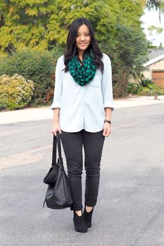 Black jeans. Chambray shirt. Green patterned scarf. Black boots.