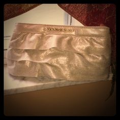 Freenext bundle purchase!!! VS clutch! Used as make-up bag...silver sparkle with gold! Gold Magnet holds it closed. 32D vs bras in my closet! Bags Cosmetic Bags & Cases
