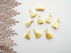 Hey, I found this really awesome Etsy listing at https://www.etsy.com/uk/listing/542452190/10-pastel-yellow-jewellery-tassels
