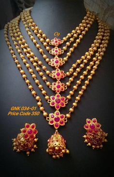 Beautiful intricate design with strands of flower shaped pendants. Comes with matching earrings.