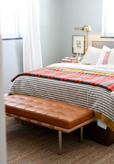 I like the low art above the nightstands-- love the bench at the foot of the bed
