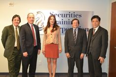 Securities Training Corporation Expands to China!  Dr. Fengbo Zhang, Leading Chinese Economist and Suprina Berenyi, International Director visit STC's New York Office. From left to right: David Snyder, Keath Fealey, Suprina Berenyi, Paul Weisman, and Dr. Fengbo Zhang.