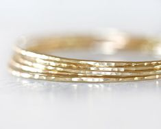 Gold Bangles / Stacking Bangles / Gold Bracelets / Chic Fashion Fresh Finds Hand Hammered Cute Unique Hipster Fashion Five Gold Bangles by amywaltz #TrendingEtsy