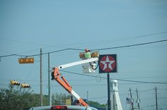 Red Light Repair ~ Inoperable traffic lights posed a horrendous threat to drivers after Hurricane Ike, especially at night. Even at major intersections, lights were virtually impossible to see before vehicles passed through. The result was a great many serious traffic accidents.