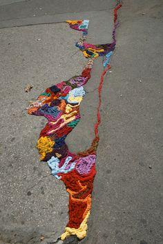 If only all our street cracks were filled like this!  Juliana Santacruz Herrera's Knitted Street Art