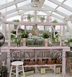 Love this PINK potting bench made with recycled materials! An old door was cut into 2 pieces to form the top shelf & the table top. The 2 pieces on either side of the top shelf are rocker arms from a rocker that had completely fell apart. An old head board was used for the back on the bottom part of the potting table. ~ from http://penny-pennystreasures.blogspot.com/2014/03/potting-table-for-new-greenhouse.html?m=1