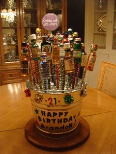"""This is a variation of the 21st Birthday Bucket I Pinned from Pinterest. I got the bucket from Ace Supply, Sparkle pipe cleaners from Walmart (also the Drinks Well With Others.. a drink coaster on the party Aisle) , and the """"rocks"""" that look just like ice cubes, from the Dollar Store. Big hit by the way!!"""