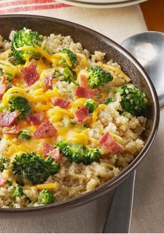 Quinoa with Broccoli, Cheese & Bacon – This risotto-style recipe with broccoli florets, cheese, and chopped bacon is made with toasty, nutty quinoa – delicious!
