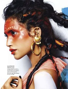 I love everything about this pic...the makeup, the hair, the earrings...it all comes together to give a truly stunning effect.