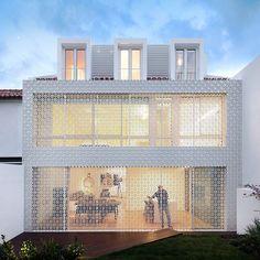 Elementos vazados vestem casa como uma renda portuguesa