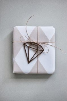 Cute wrapping with a diamond bow...cute for a mom, sister, BFF or another close female.                                                                                                                                                                                 More