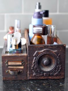 Here, mismatched vintage dresser drawers store the scourge of bathroom counters everywhere: makeup and hair products.