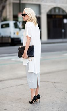 I love the proportions here of the anrrow skirt, high heels, and voluminous top #style #fashion #white