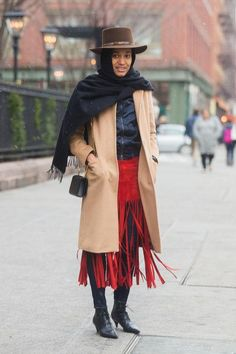 A layered winter outfit, put together by blogger Tamu McPherson, proves that fun and function work.