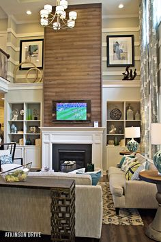 Home-a-Rama 2014: Cozy family room with floor-to-ceiling wood fireplace focal wall  | Atkinson Drive